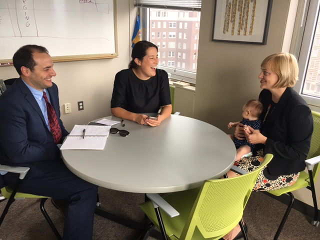 (L-R: Adam Agalloco, energy manager; Sarah Wu, deputy director; and Christine Knapp, director, all of the Philadelphia Office of Sustainability, in Knapp´s office after a news conference announcing new clean energy goals for the city.)