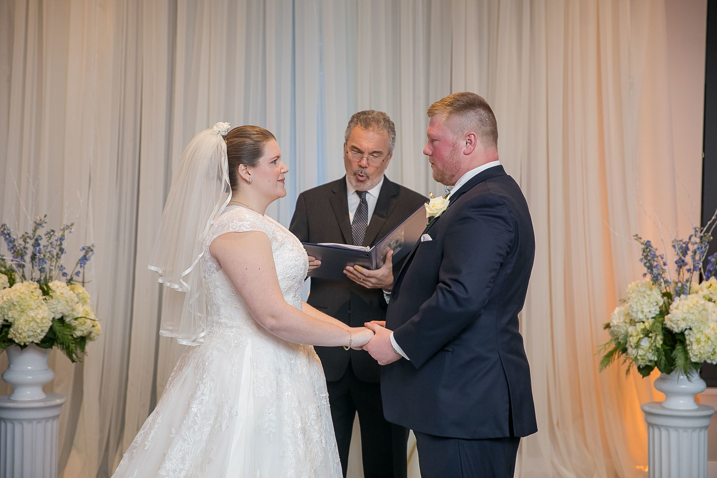 Camille Griswold and Dan Cooler, with officiant Kevin Barr.