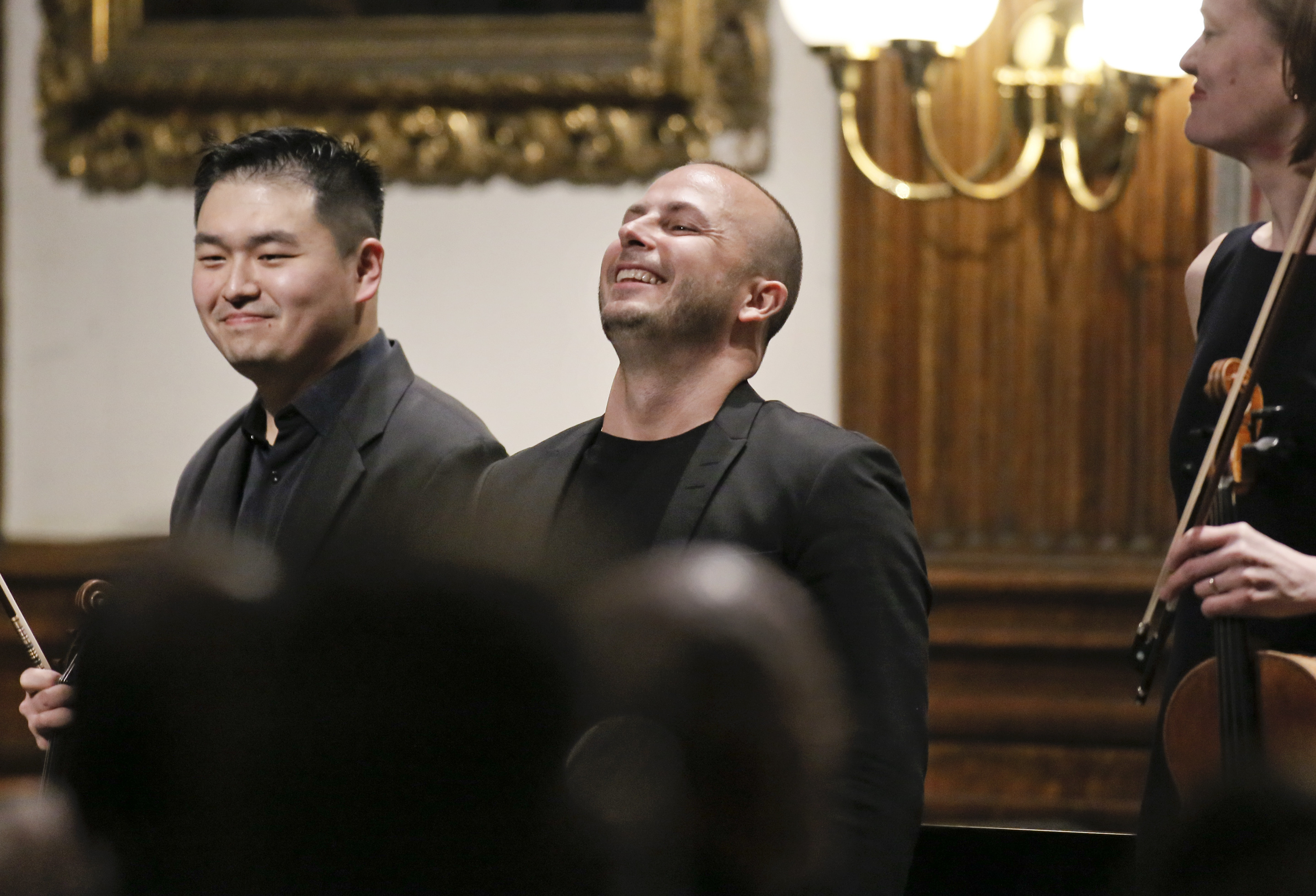 Yannick Nezet-Seguin (center) after plaiyng the piano with musicians from the Philadelphia Orchestra at a Chamber Concert in historic Mitchell Hall at The College of Physicians in Phila., Pa. on April 11, 2018. ELIZABETH ROBERTSON / Staff Photographer