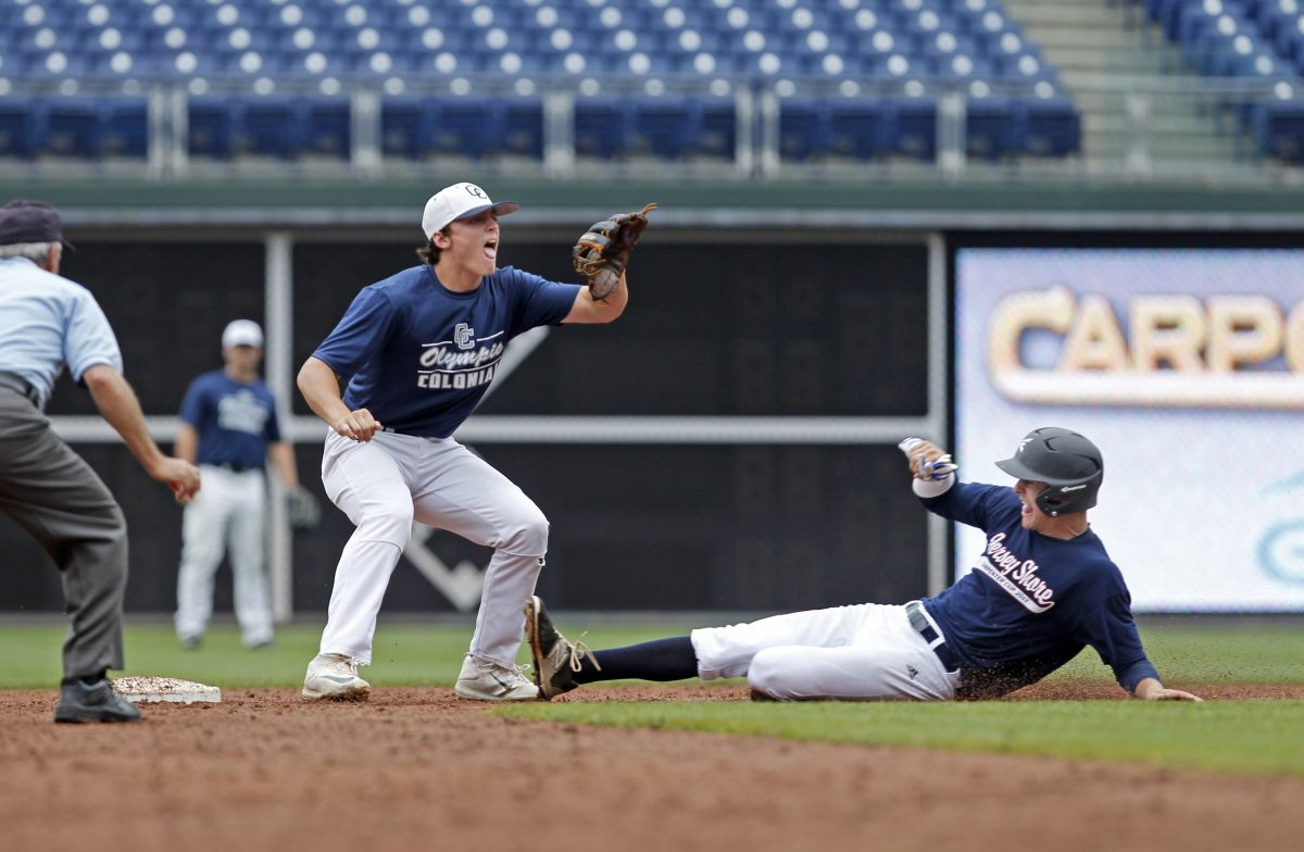 Jersey Shore's Mike Nyisztor right, steals second base as Olympic Colonial's Jake Toplski waits for the ball during game 1 of the Carpenter Cup semifinals baseball game, Friday June 23, 2017, in Philadelphia.  Jersey Shore won 12-7. ( H. Rumph Jr / For the Inquirer )