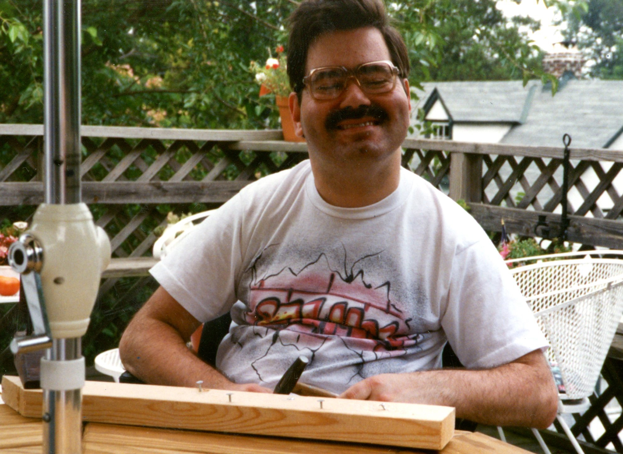 Vincent McNamara on the deck of his sister Maureen´s house in Erdenheim in 1998, clearly pleased with the hammering he did on the board in front of him.