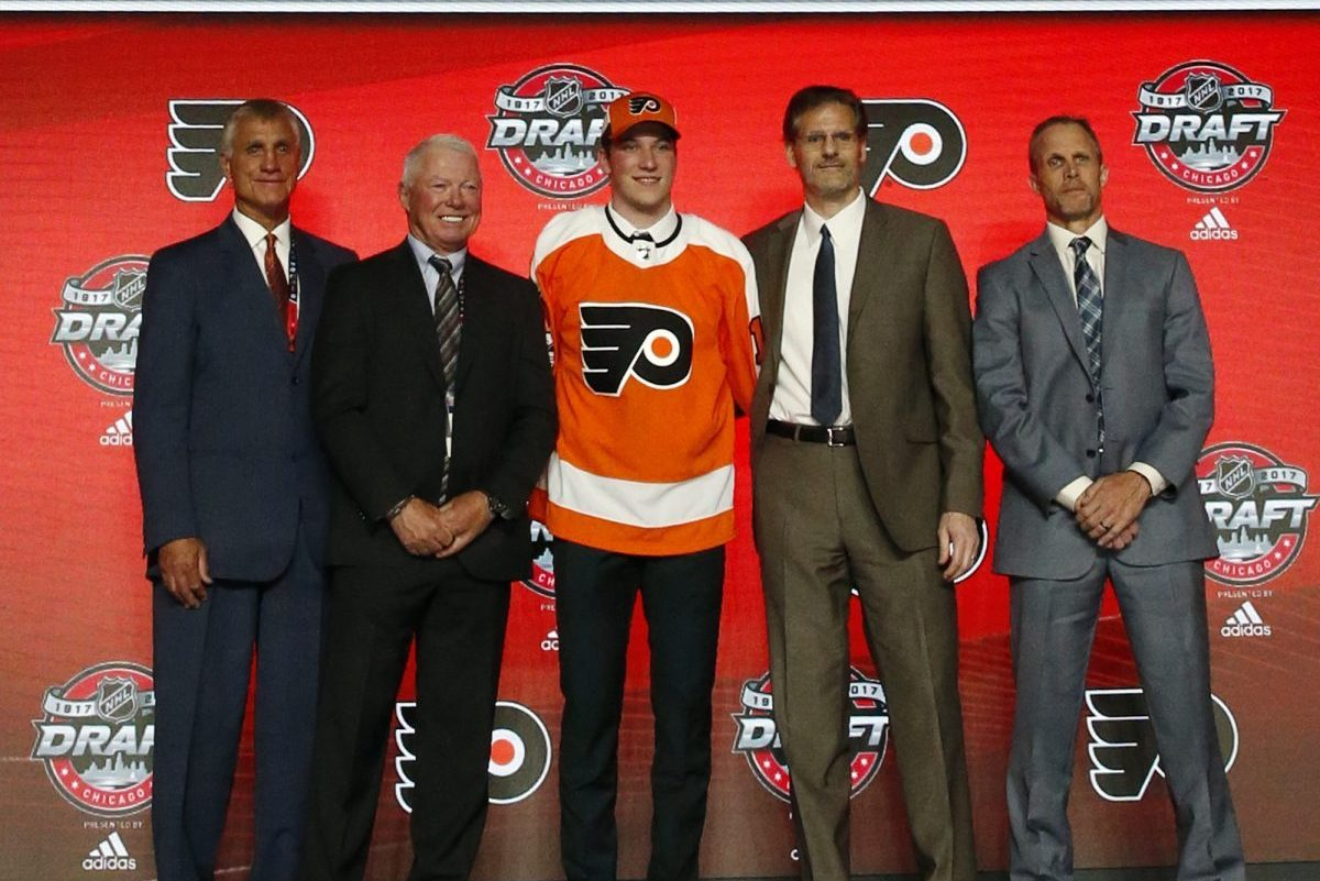 Nolan Patrick, center, wears a Flyers jersey after being selected by the team in the first round of the NHL draft, Friday, June 23, 2017, in Chicago. (AP Photo/Nam Y. Huh)