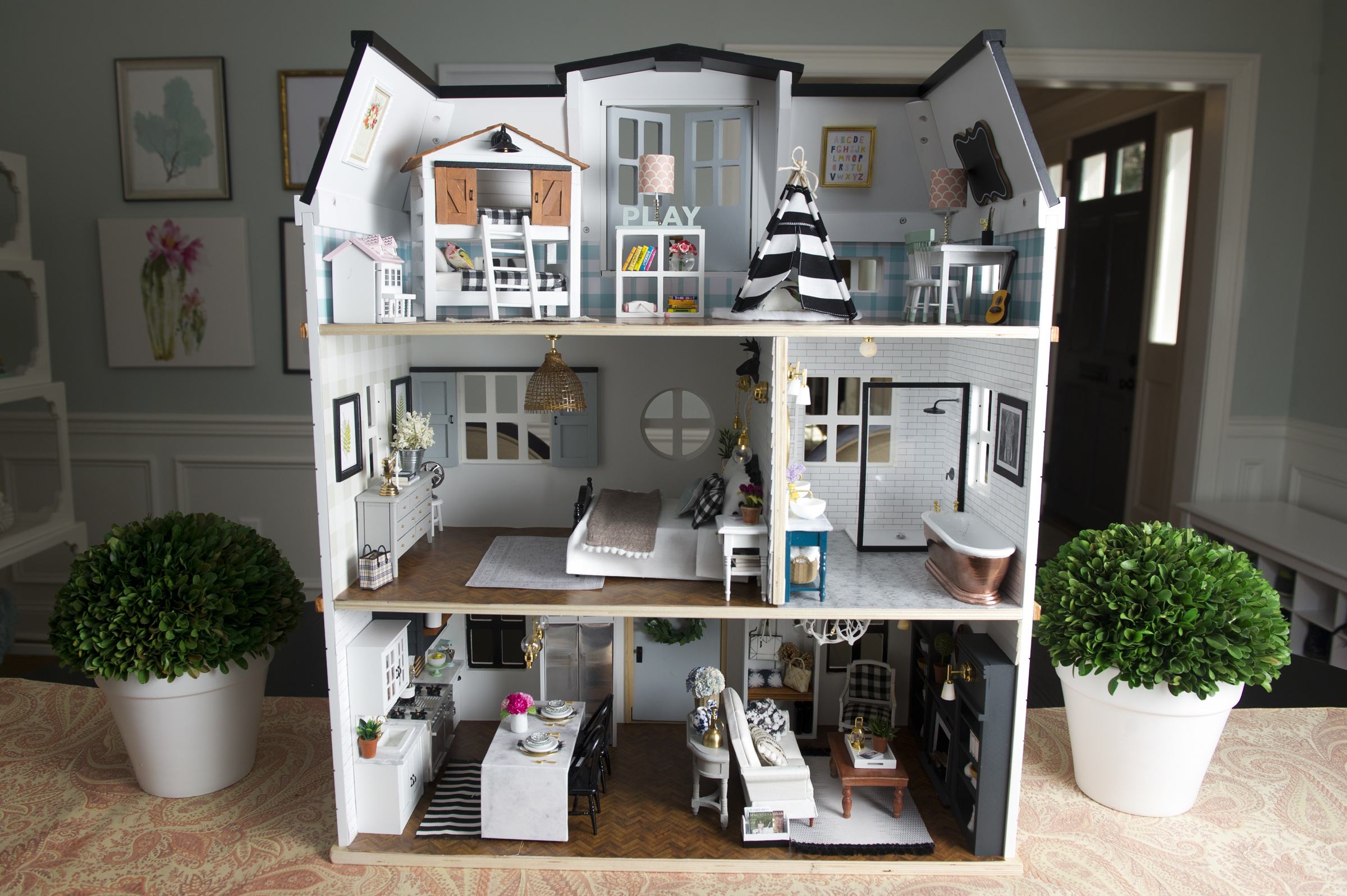 Dr. Kwandaa Roberts´ dollhouse that´s decorated in the style of HGTV´s Chip and Joanna Gaines from their TV show Fixer Upper.