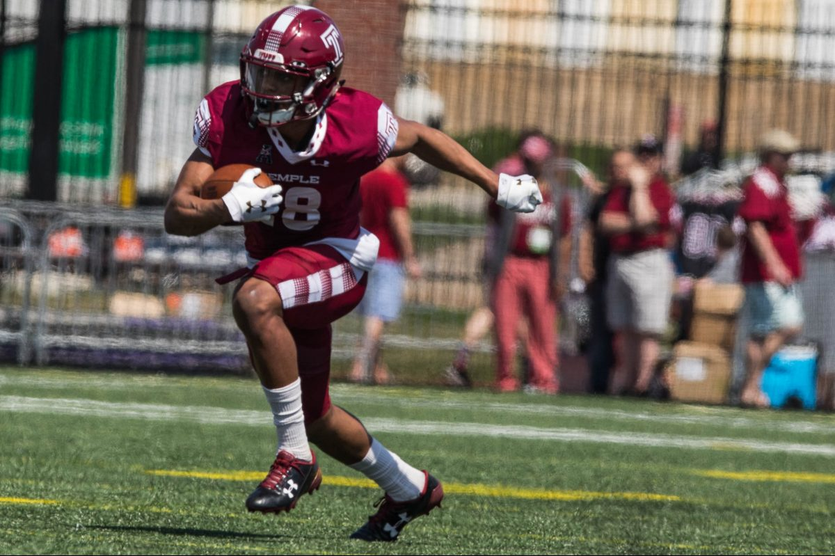 Temple's wide receiver Jadan Blue, on the Cherry team, runs with the ball during the team's spring football game.