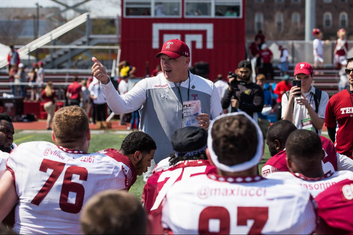 Temple football head coach Geoff Collins speaks with his players on the field after the Cherry and White game.
