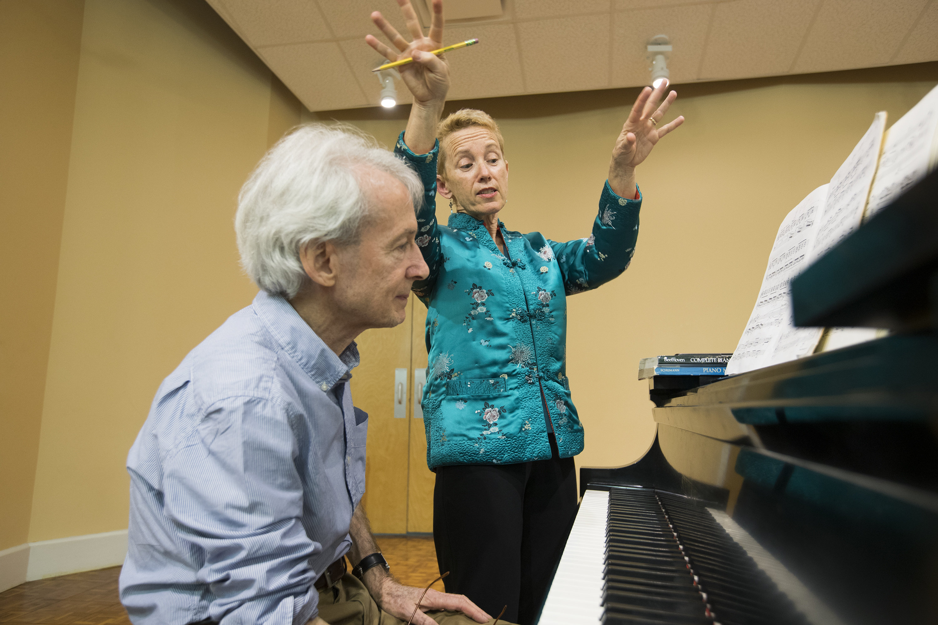 Linda Reichert, right, works with Len Rieser at the Germantown branch of the Settlement Music School to prepare for a recital,