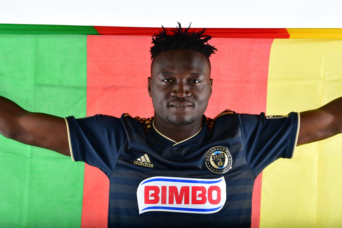 Olivier Mbaizo holds up the flag of his native Cameroon after signing a MLS contract with the Philadelphia Union. Mbaizo had been with Bethlehem Steel, the Union's USL affiliate, since January.