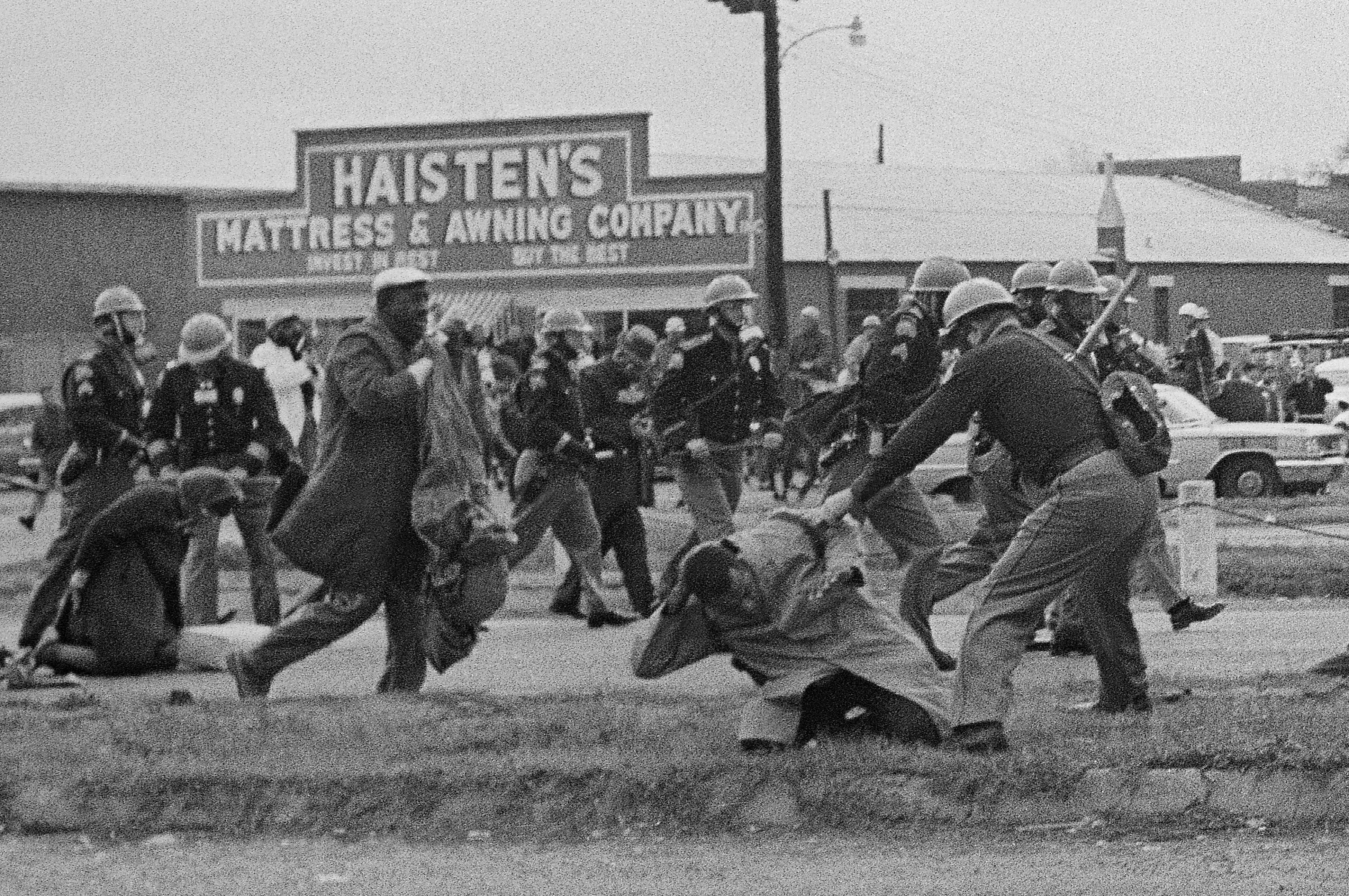 State troopers swing billy clubs to break up a civil rights voting march in Selma, Ala., March 7, 1965. John Lewis, chairman of the Student Nonviolent Coordinating Committee is being beaten (in the foreground) by a state trooper. Lewis, a future U.S. Congressman, sustained a fractured skull. (AP Photo)