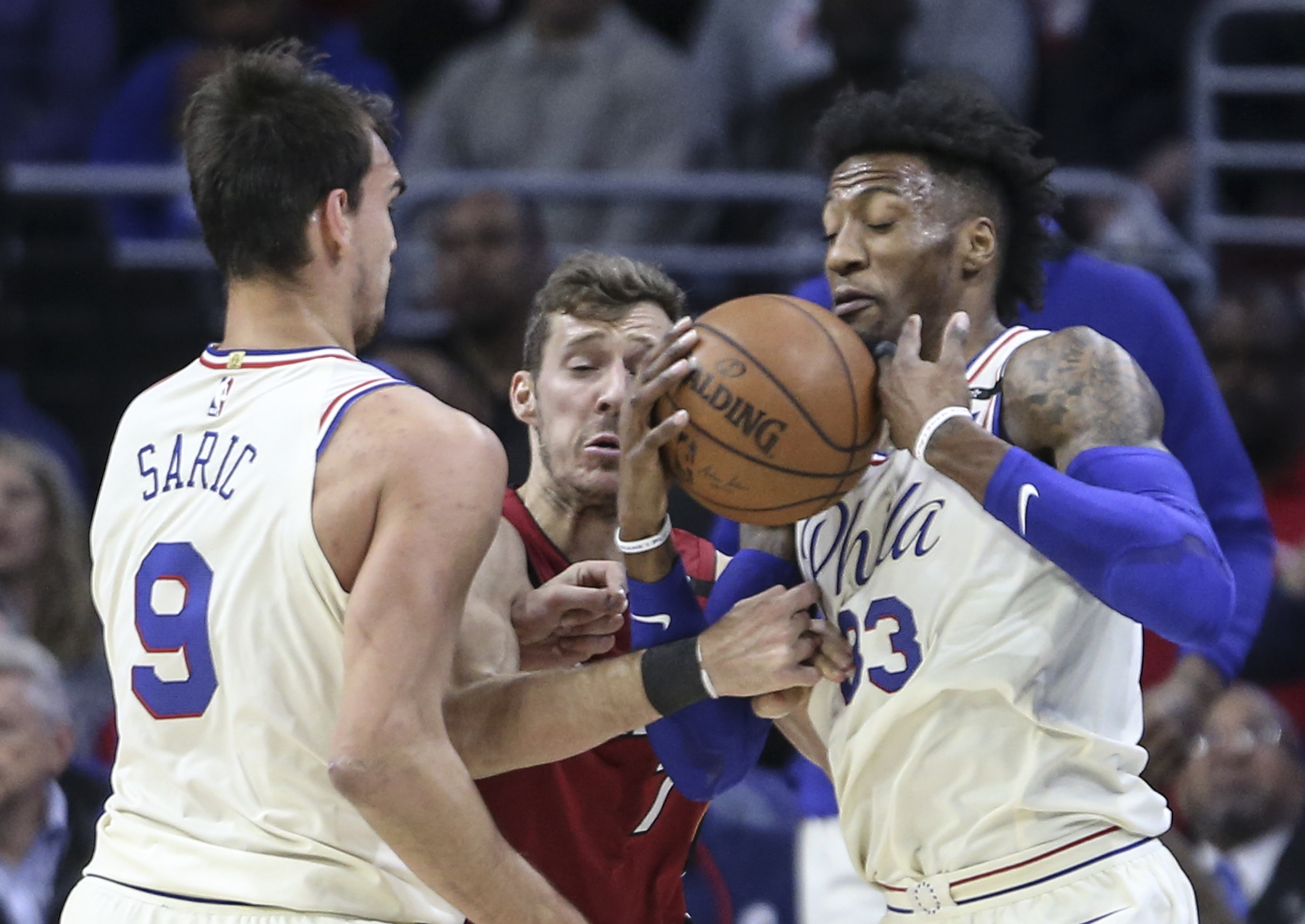 Sixers´ Dario Saric and Robert Covington keep the ball from the Heat´s Goran Dragic during the 1st quarter of Game 2 of the 2018 Playoffs at the Wells Fargo Center in Philadelphia, Monday, April 16, 2018. STEVEN M. FALK / Staff Photographer
