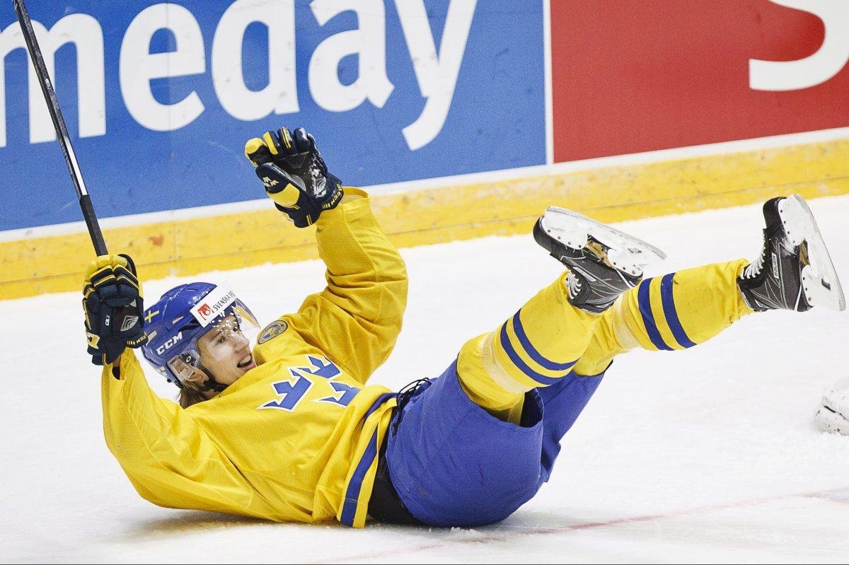 Sweden's Oskar Lindblom celebrates scoring against Slovakia during the 2016 IIHF World Junior Ice Hockey Championships.