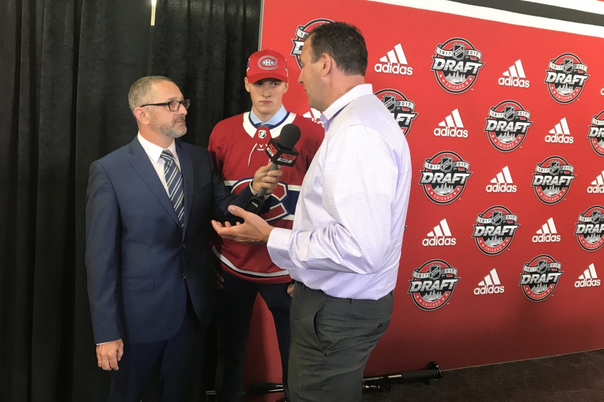 Former Flyer Keith Primeau (right) with his son, Cayden (center), at the NHL draft on Saturday. Cayden was selected in the seventh round by Montreal. SAM CARCHIDI/Staff