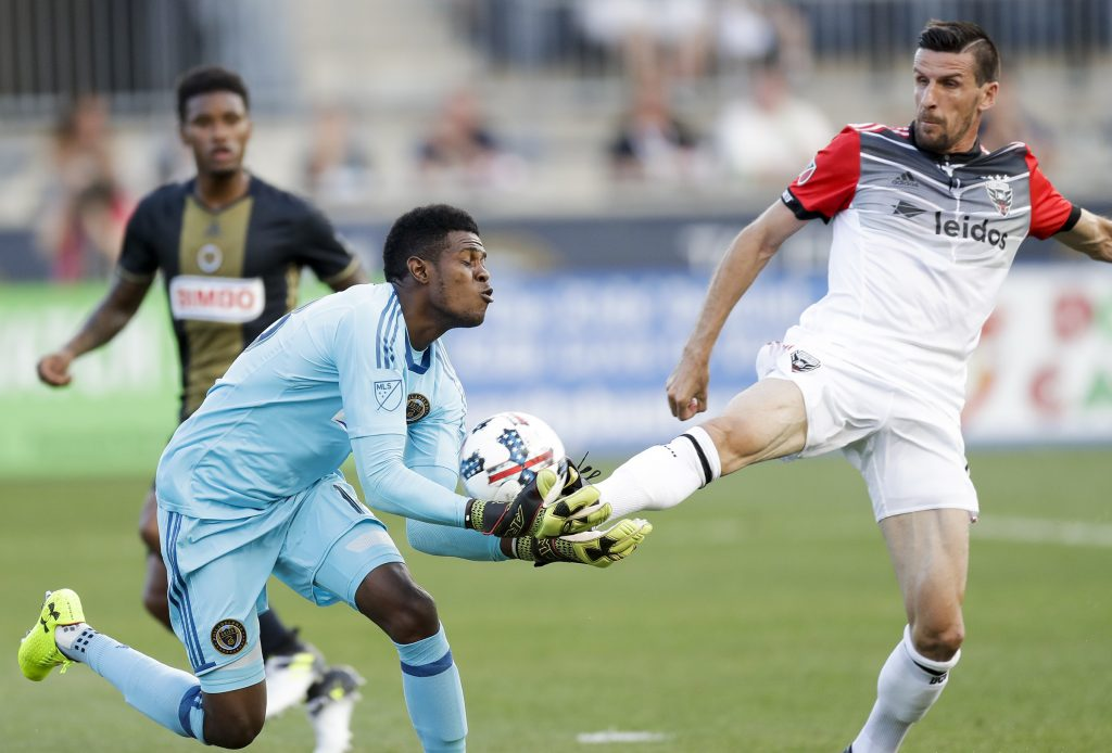Union goalkeeper Andre Blake makes a save against D.C. United forward Sebastien Le Toux. YONG KIM / Staff Photographer