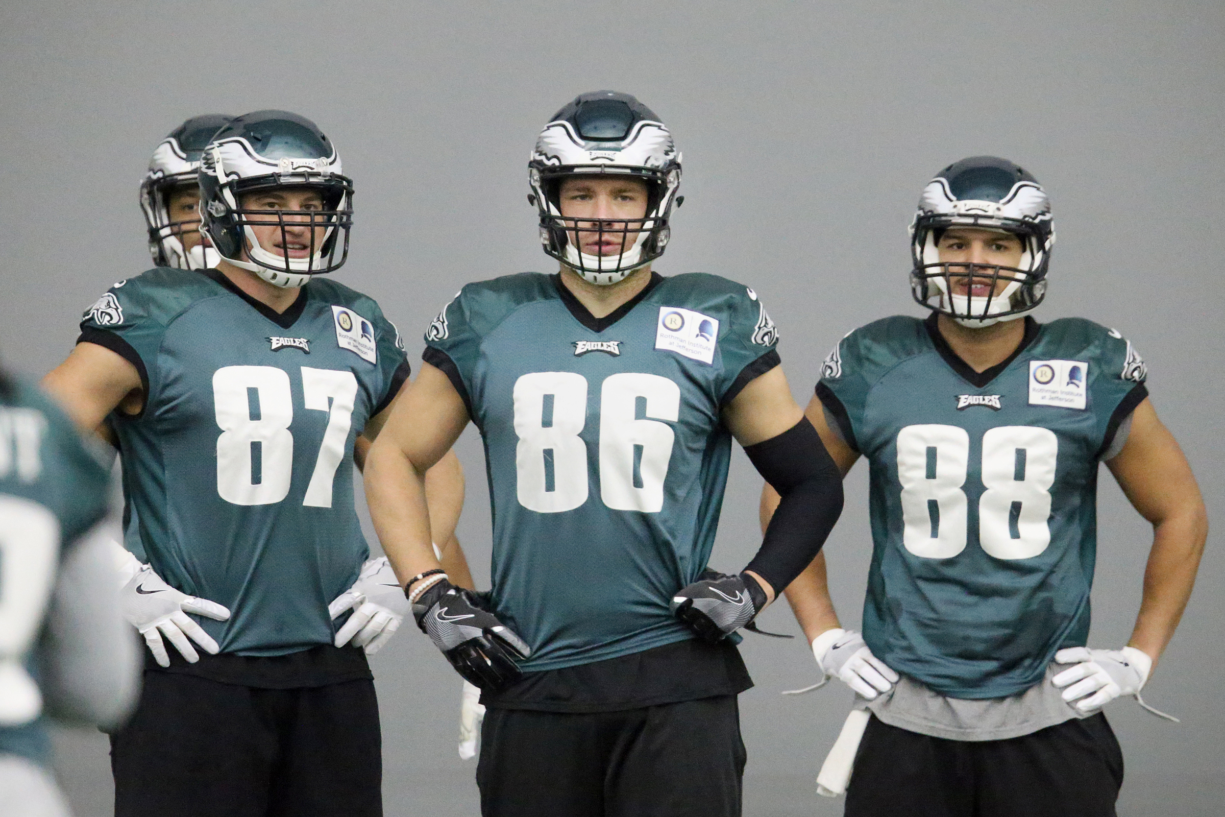 Zach Ertz (86) stands between former teammates Brent Celek (87) and Trey Burton (88) during an Eagles practice the week before the Super Bowl.