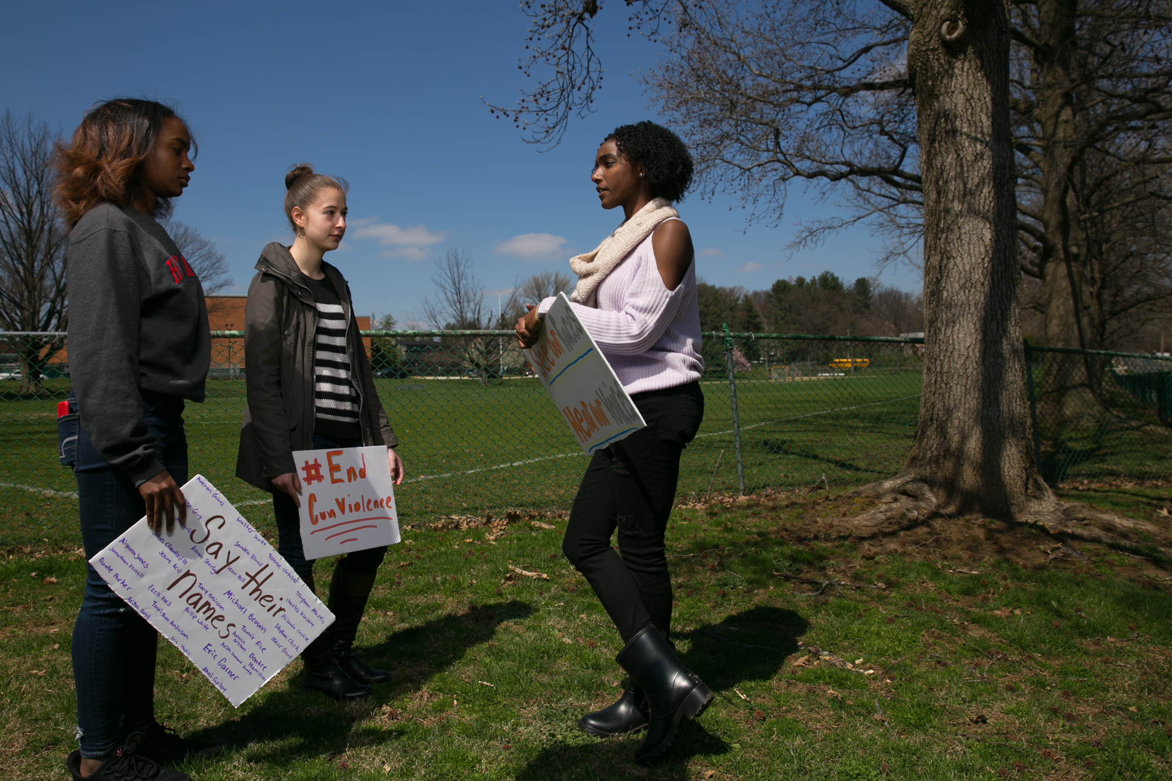 Arianna Wallace, left, Eve Glazier, center, and Eryn Banton, right, three of the students concerned about gun violence who organized a walkout this Friday, shown here in front of Cheltenham High School, Wednesday, April 18, 2018. JESSICA GRIFFIN / Staff Photographer.