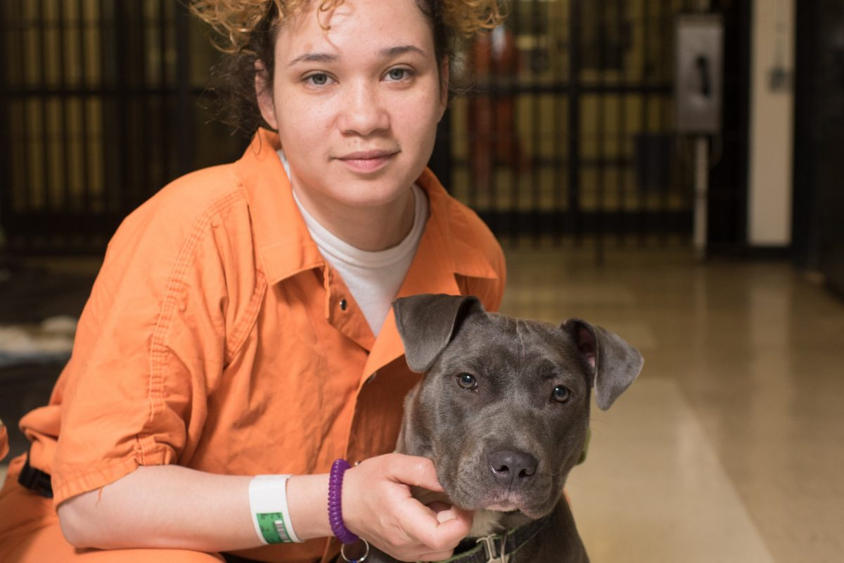 Bryon Murphy and her dog, Olympia, train with New Leash on Life, a Philadelphia nonprofit that teaches inmates dog-training and grooming skills so they can find work once they leave prison.