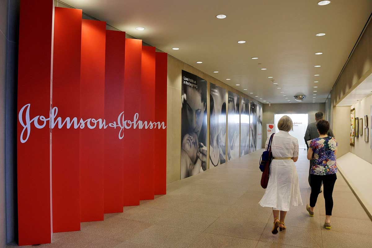 In this July 30, 2013, file photo, people walk along a corridor at the headquarters of Johnson & Johnson in New Brunswick, N.J. Janssen is a subsidiary of Johnson & Johnson.