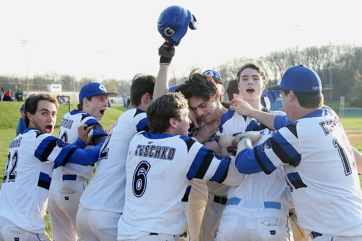 Gateway players mob Jackson Kelly, who had the game-winning grand slam against Haddon Township at Gateway Regional High School in Woodbury Heights, N.J., on Wednesday.