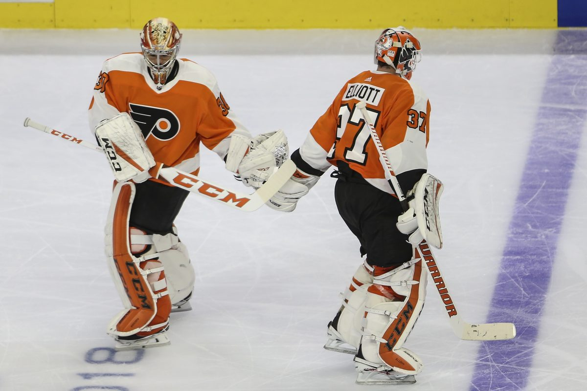 Michal Neuvirth (left) replaced Brian Elliott in goal for the Flyers on Wednesday after the Penguins' third goal.