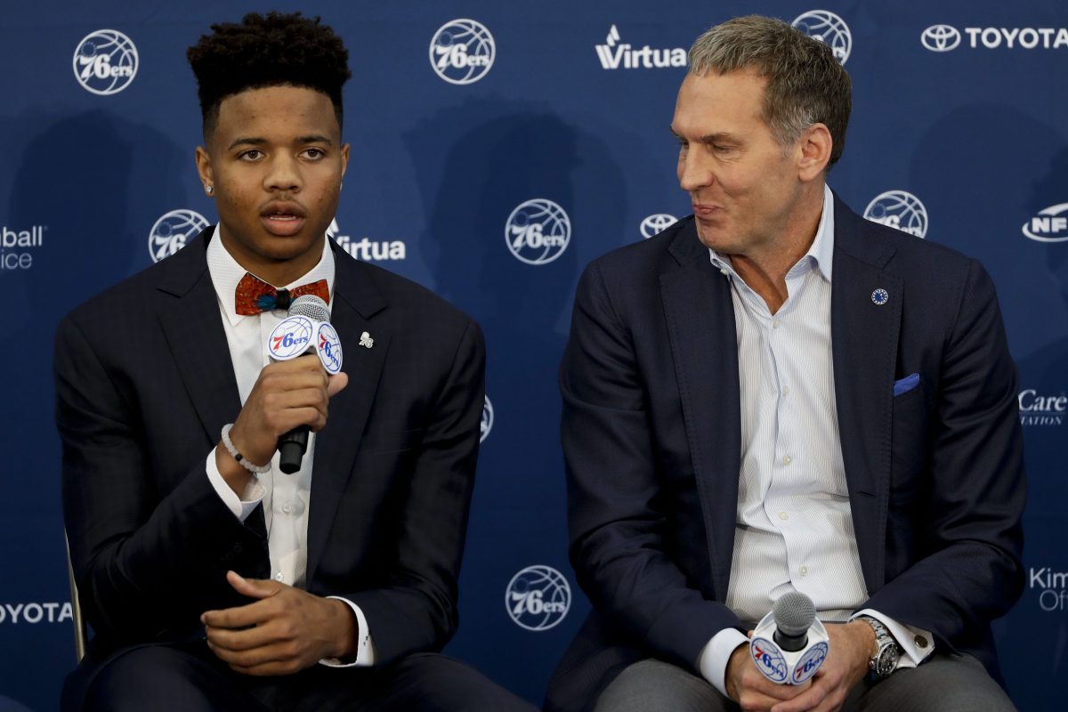 Markelle Fultz (left), next to Sixers president Bryan Colangelo, is part of the optimism surrounding the four main pro teams in Philly.