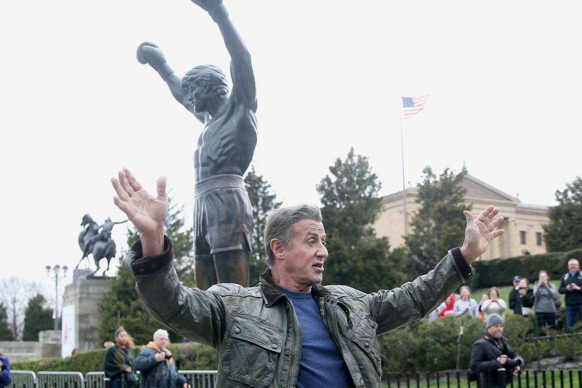 Actor Sylvester Stallone waves to fans while visiting the Rocky statue outside the Philadelphia Museum of Art on Friday, April 6, 2018. Stallone.