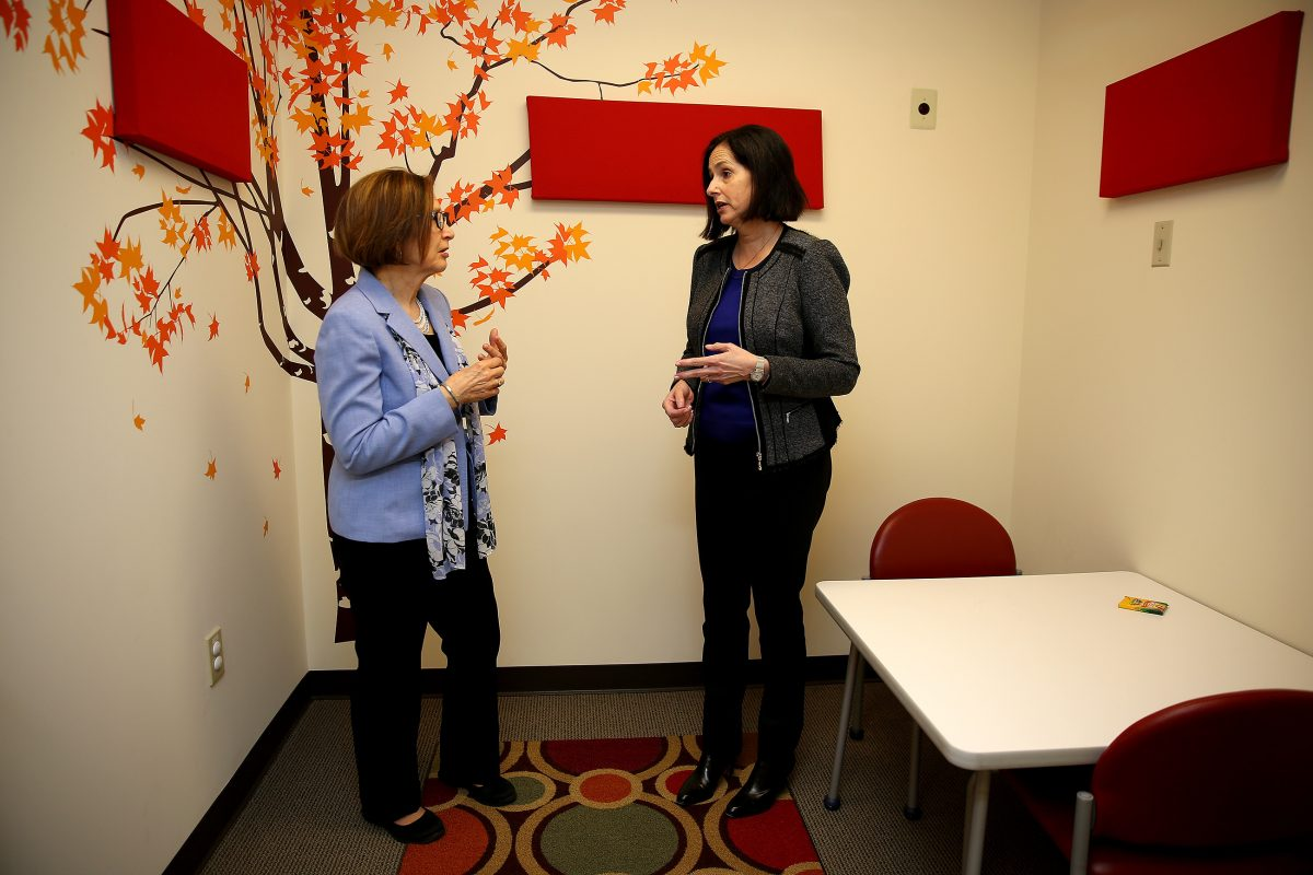 Beth Sturman (left), executive director of domestic violence agency Laurel House, talks with Abbie Newman, CEO of Mission Kids Child Advocacy Center of Montgomery County, in a child interview room in East Norriton, Pa., on April 19, 2018.