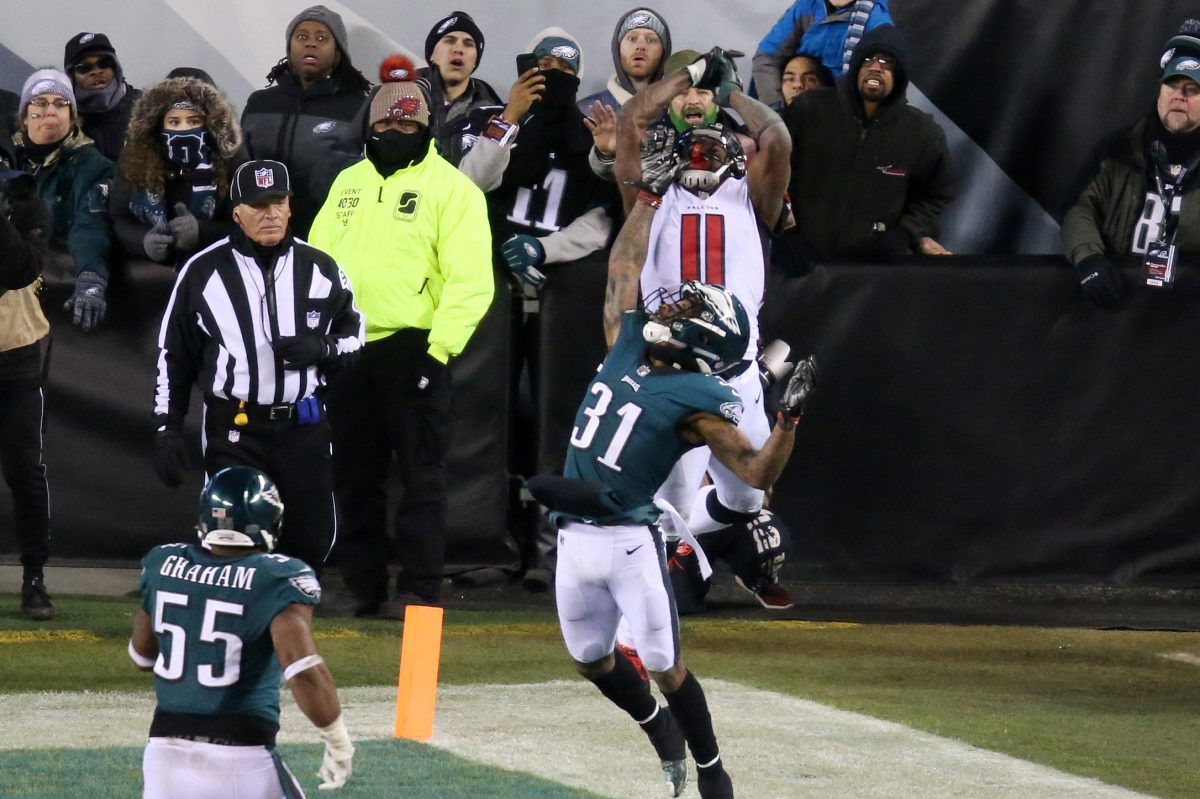Falcons wide receiver Julio Jones (11) couldn't catch a pass under pressure from Eagles cornerback Jalen Mills (31) late in the Eagles´ playoff win against the Falcons at Lincoln Financial Field on Jan. 13.