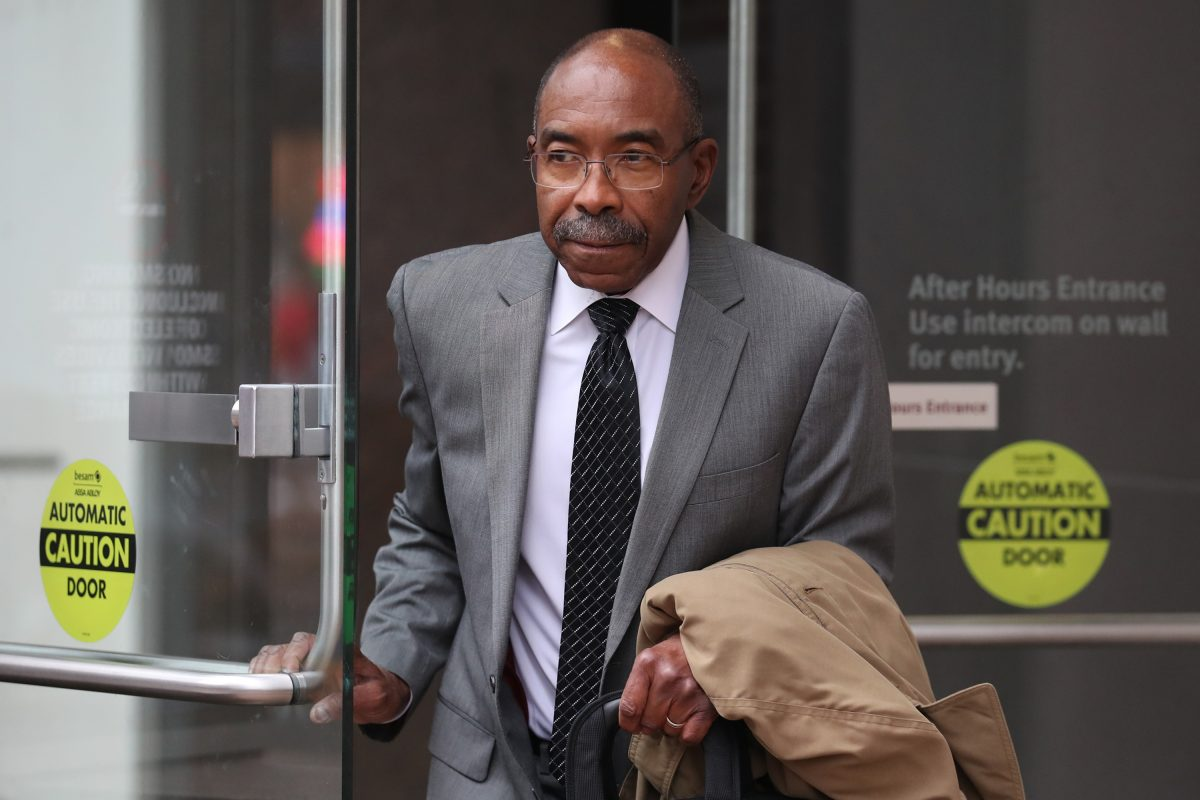 Former Philadelphia Sheriff John Green leaves federal court on April 3, the day a jury cleared him of some charges and deadlocked on others. He now faces a retrial.