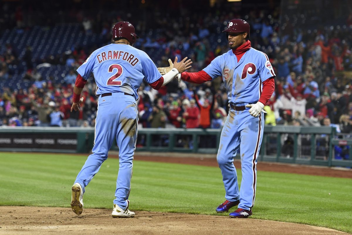 Phillies outfielder Nick Williams (right) celebrates with shortstop J.P. Crawford after Cesar Hernandez's three-run single against the Pirates on Thursday.
