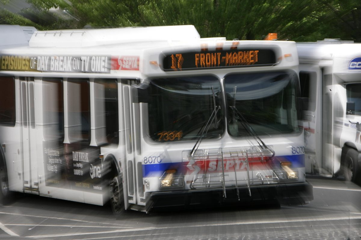 A SEPTA bus in Philadelphia. The driver of another bus is already using Sixers NBA championship messaging.