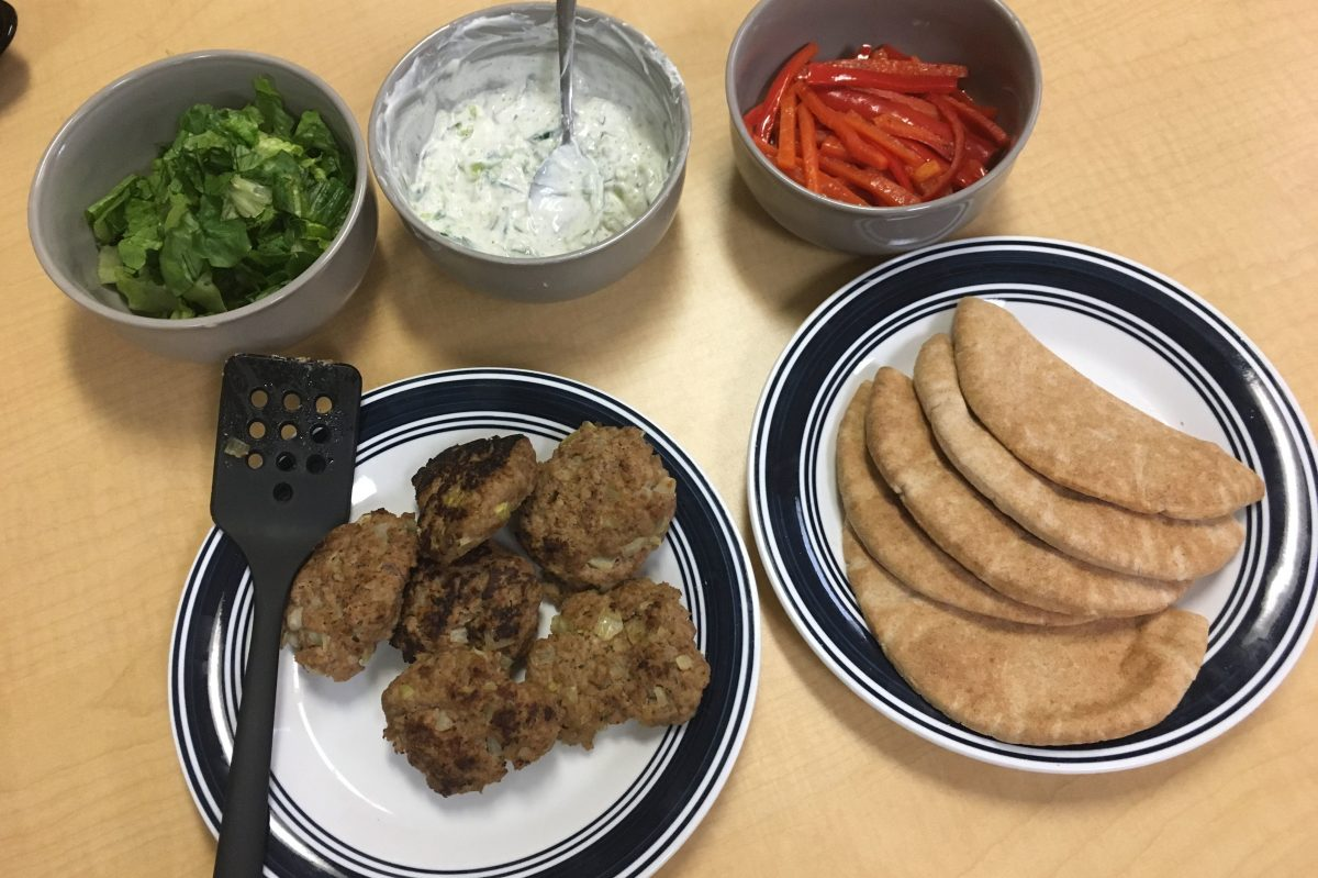 Greek Turkey Burgers with condiments of Tzatziki sauce, lettuce and roasted peppers to be served in pita pockets as prepared by students at Universal Daroff Charter School in West Philadelphia.