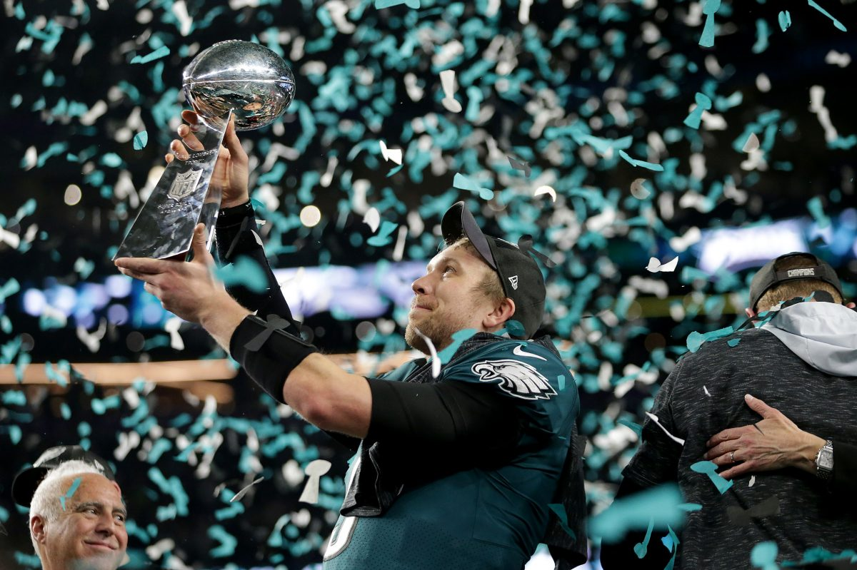 Nick Foles admires the Lombardi Trophy after he passed for 373 yards and three touchdowns in an MVP performance. He'll be back for the 2018 season.