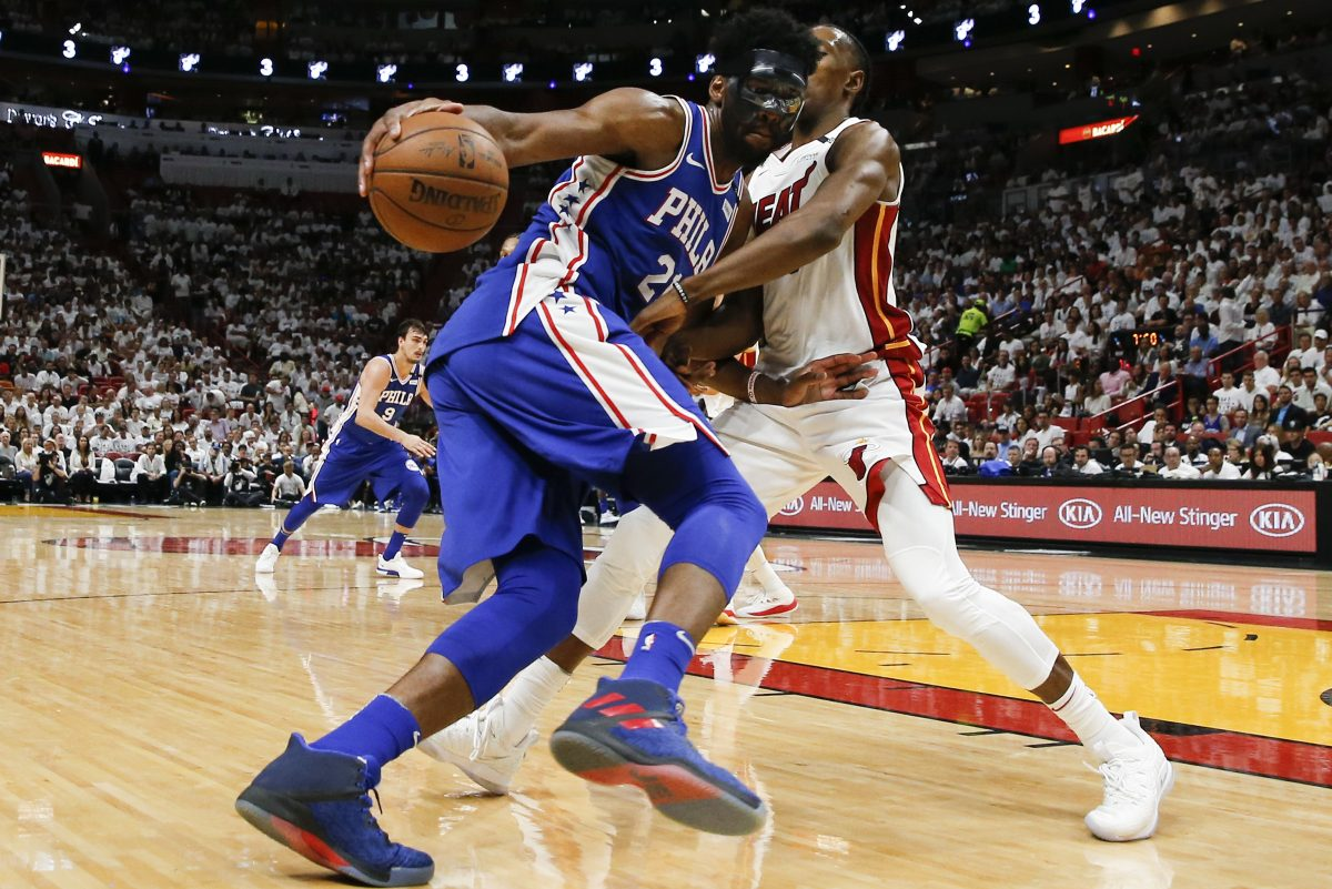 Sixers center Joel Embiid drives on Heat forward Josh Richardson during the Sixers' Game 3 win on Thursday.
