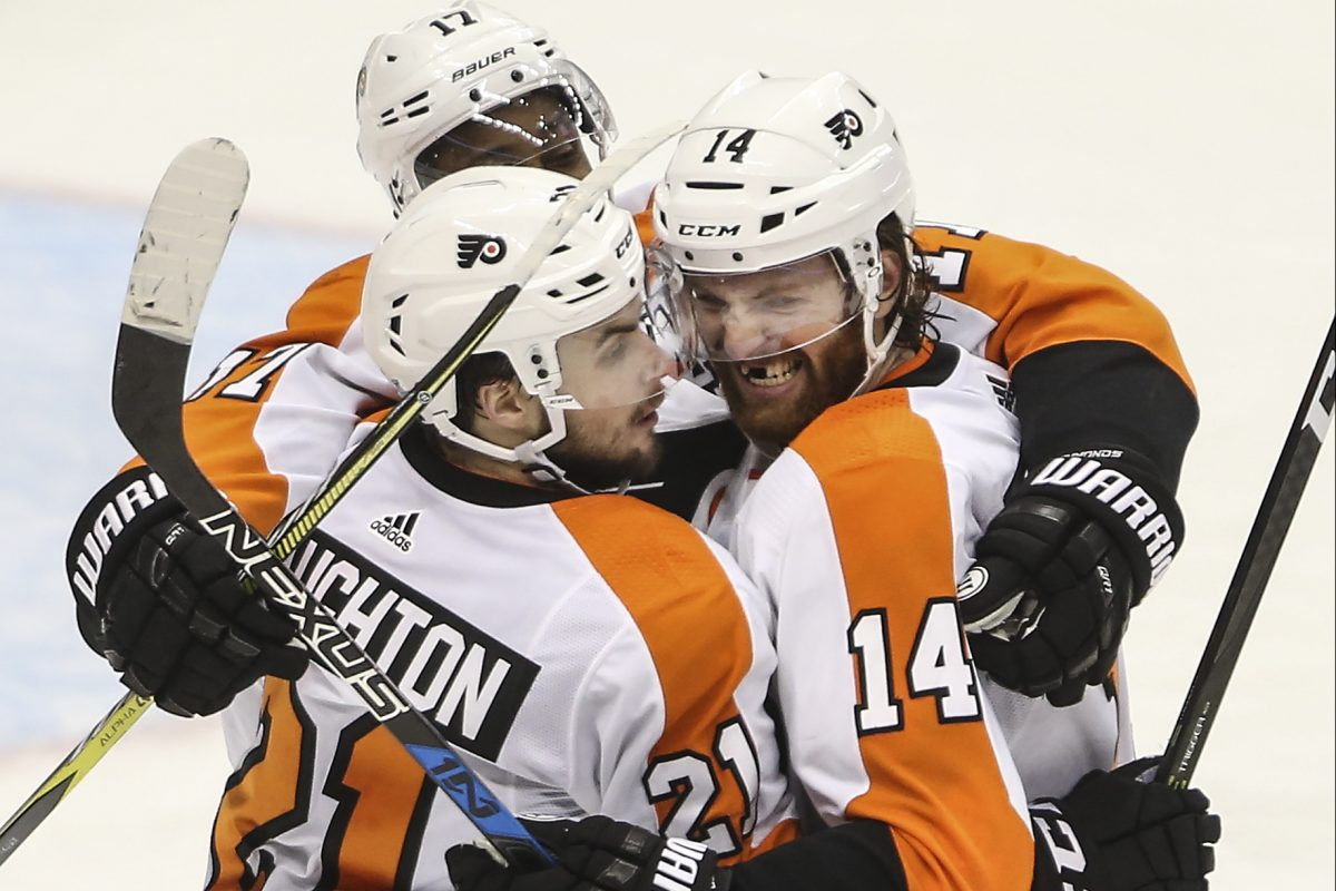 Flyers' forward Sean Couturier celebrates his go-ahead goal against the Penguins on Friday.