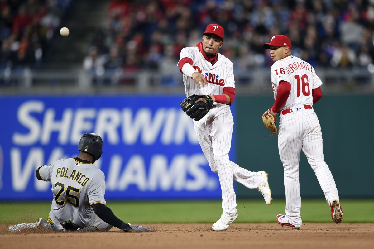Phillies shortstop J.P. Crawford tries to turn two during the Phillies 2-1 win over the Pirates on Friday.