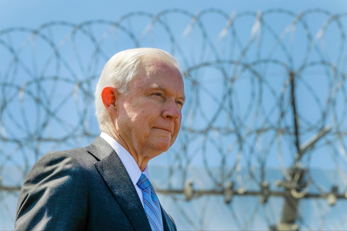 In this Friday, April 21, 2017, file photo, United States Attorney General Jeff Sessions stands near a secondary border fence during a news conference at the U.S.-Mexican border next to the Brown Field Border Patrol Station in San Diego.
