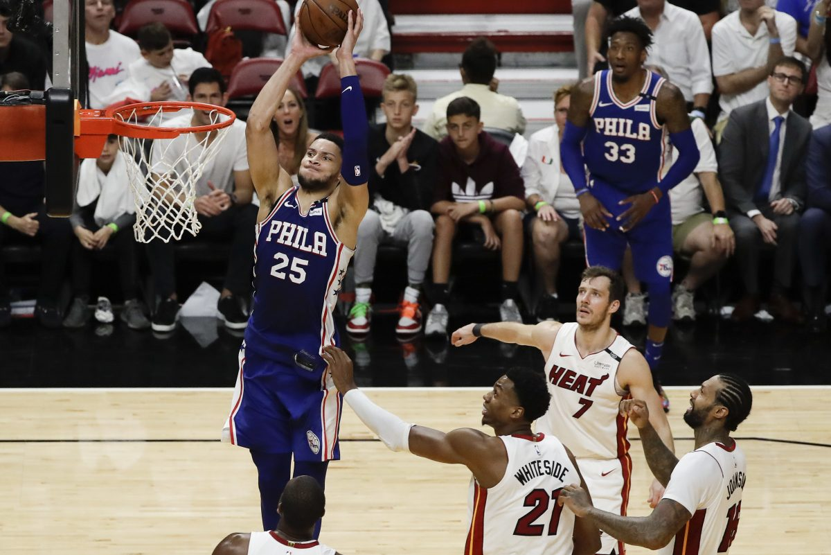 Sixers guard Ben Simmons goes up to dunk the basketball past several Miami Heat players during the Sixers' game 4 win on Saturday.