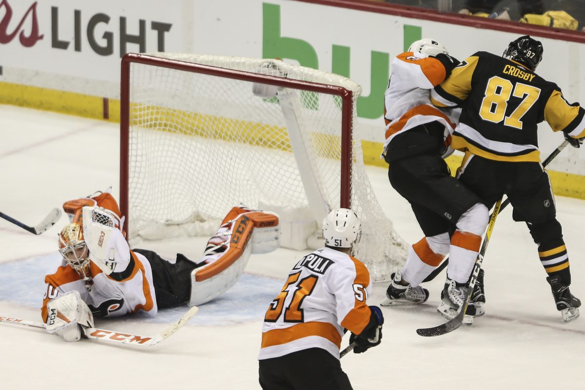 Goalie Michal Neuvirth makes a glove save against Pittsburgh's  Sidney Crosby with 50 seconds left in Game 5 and the Flyers leading, 3-2. They won, 4-2.
