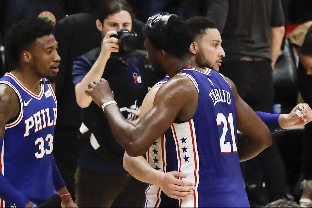 Sixers center Joel Embiid, guard Ben Simmons and forward Robert Covington celebrate their 106-102 win over the Heat in game four of the first round of the playoffs on Saturday.