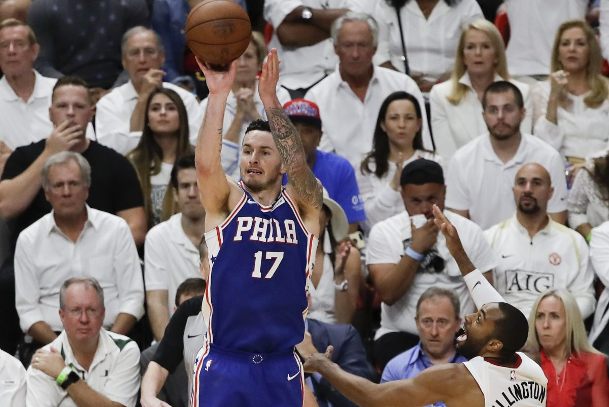 Sixers guard JJ Redick shoots the basketball over Heat guard Wayne Ellington during game four of the Eastern Conference quarterfinals on Saturday.