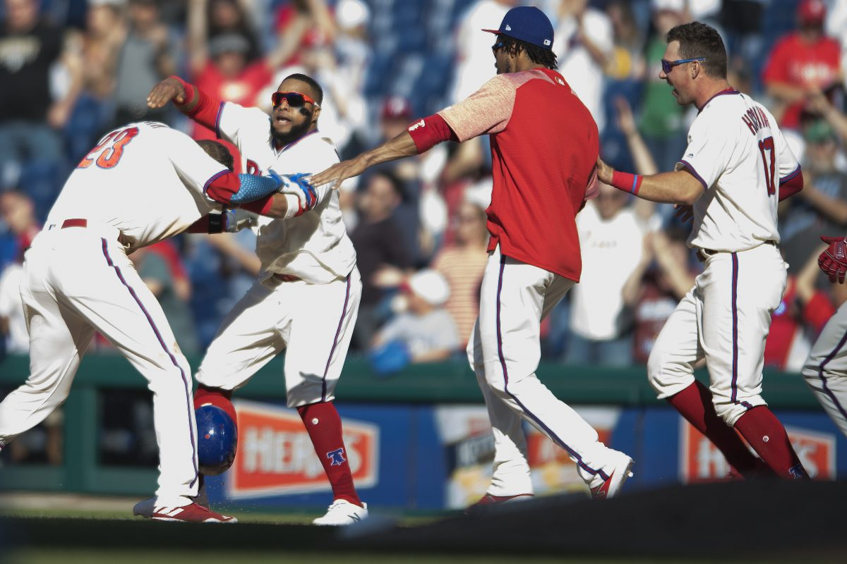 Phillies outfielder Aaron Altherr (left) is congratulated by Carlos Santana, and teammates after winning the game with an RBI single in the 11th inning against the Pirates at Citizens Bank Park.