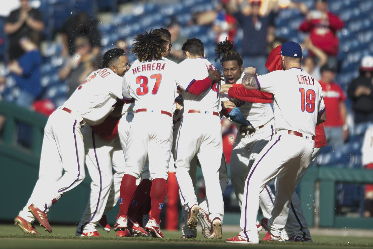 Phillies players mob Aaron Altherr (23) after his walk-off hit against the Pirates.