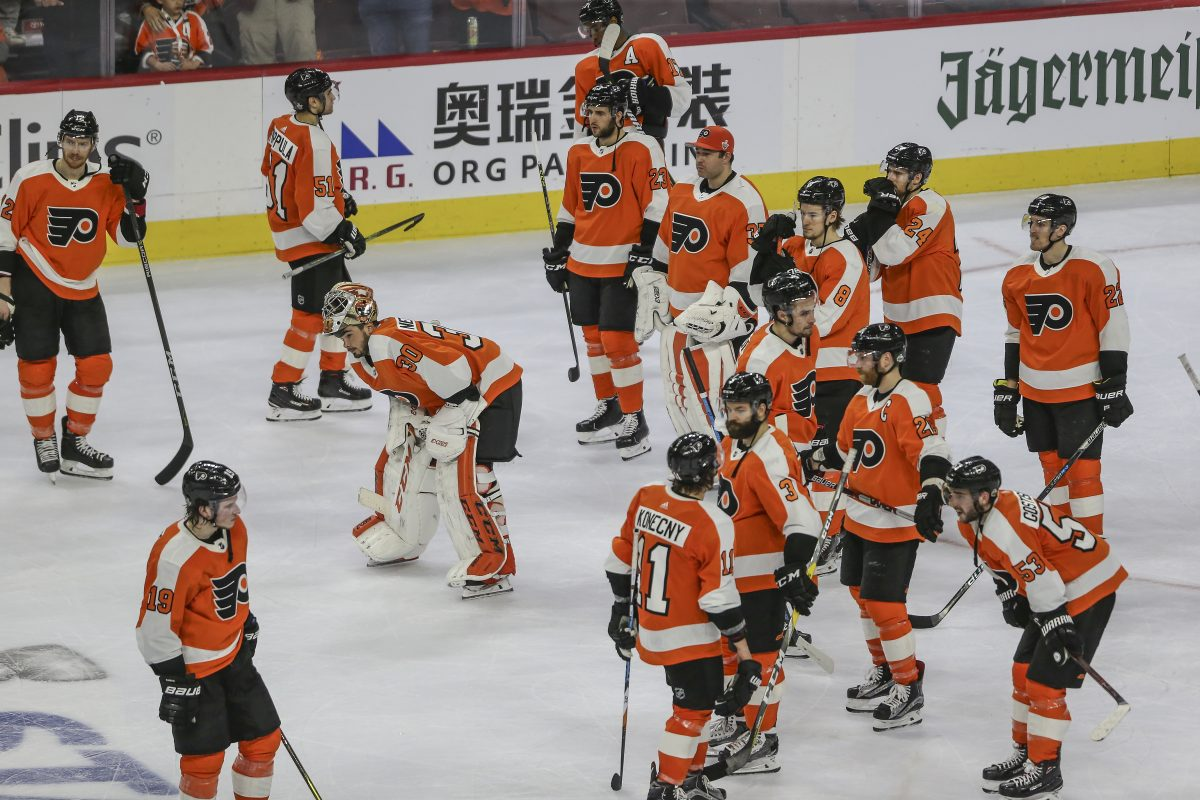 Dejected Flyers players after losing their first-round series to the Penguins on Sunday.