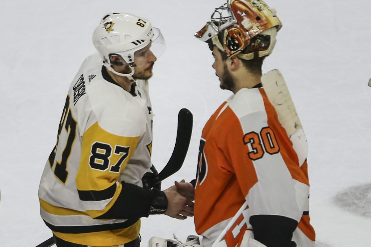 Goalie Michal Neuvirth shakes hands with Penguins captain Sidney Crosby at the end of their first-round series.