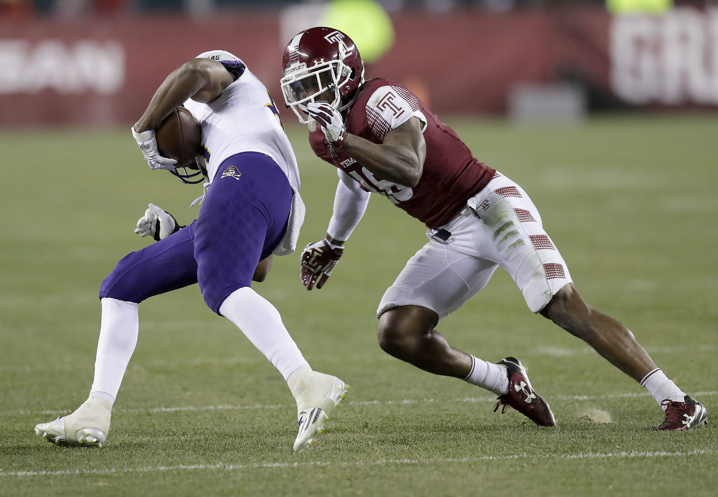 Temple defensive back Artrel Foster goes after East Carolina wide receiver Jimmy Williams on Saturday, November 26, 2016 in Philadelphia. YONG KIM / Staff Photographer