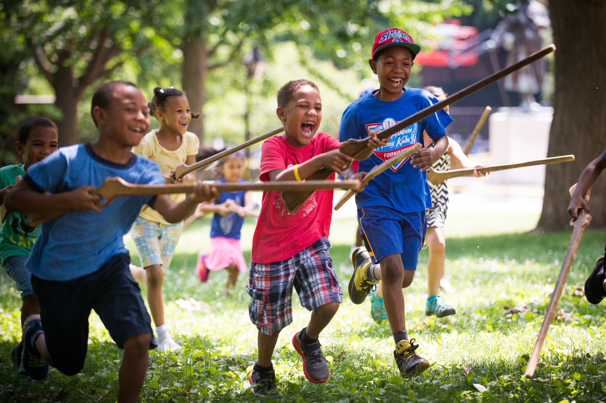Children take part in a mock revolutionary muster hosted by actors from historic Philadelphia in a park behind the American Philisophical Society.