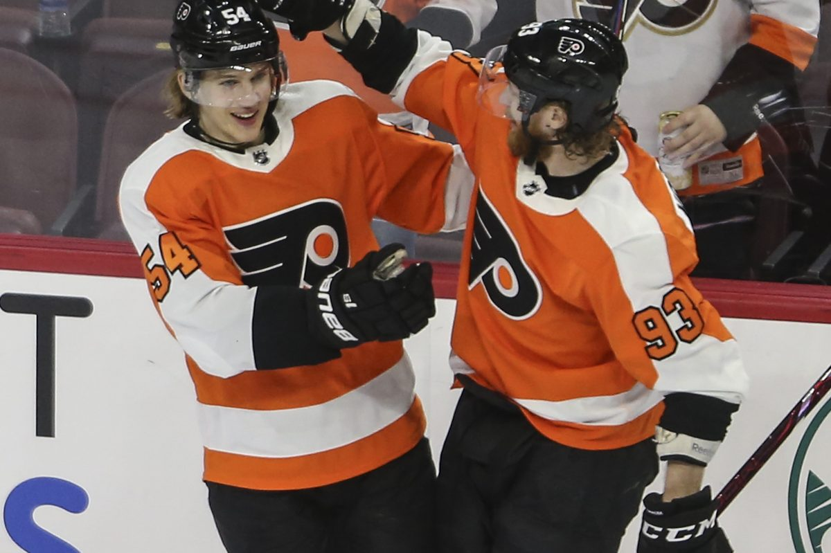 Oskar Lindblom (left) celebrates his goal against the New York Rangers with teammate Jake Voracek in the Flyers' 4-3 win on March 22.