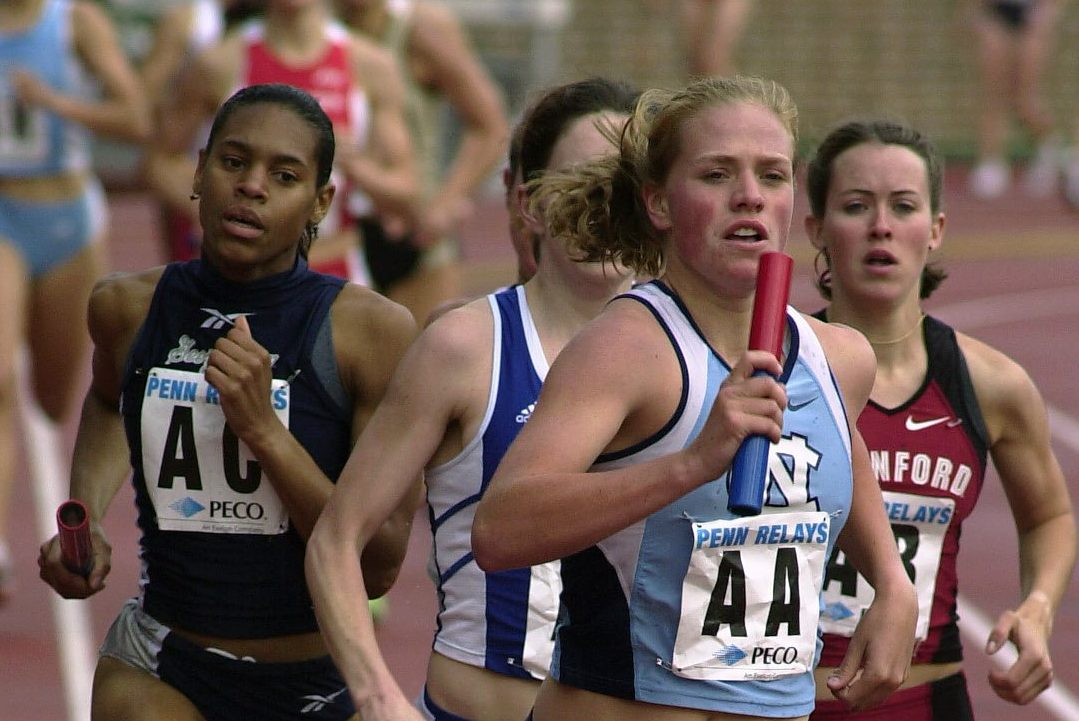 Erin Donohue, then a freshman at North Carolina, leads the pack in the first leg of the women's distance medley relay at the Penn Relays in April 2002.