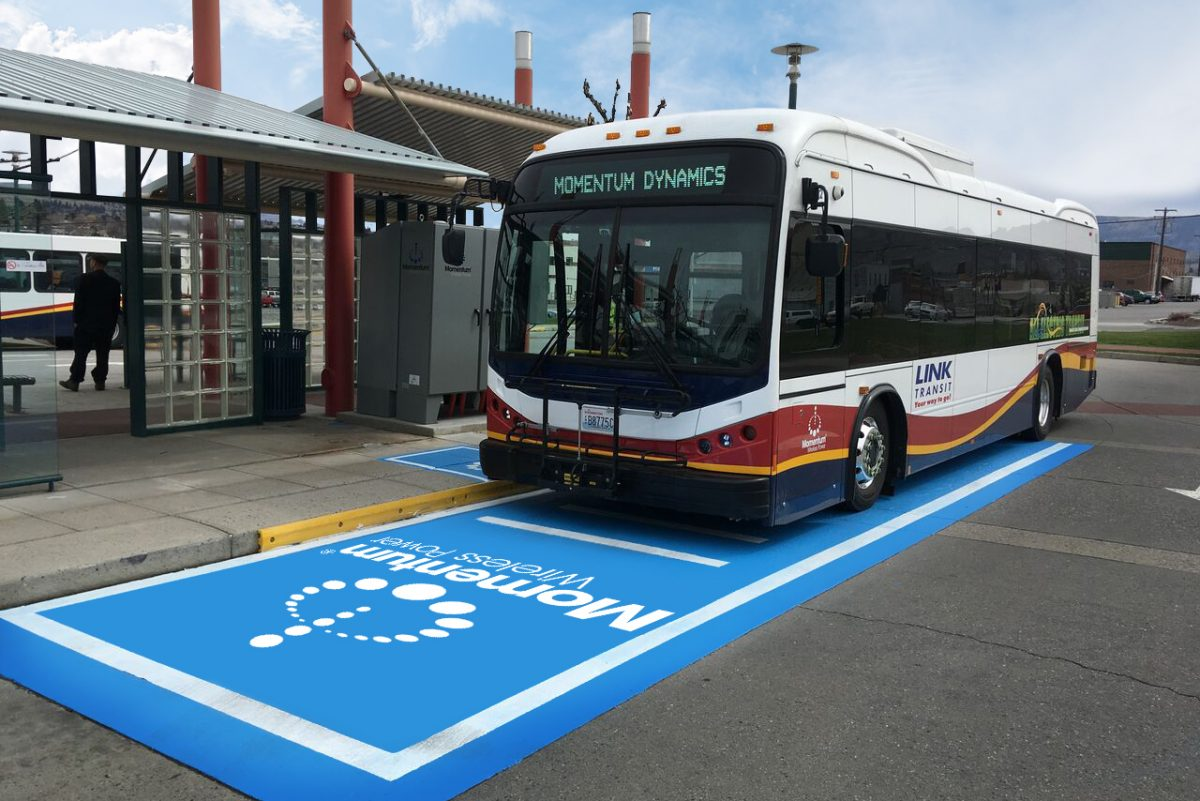 An electric bus in Wenatchee, Wash., is positioned over a wireless charging pad that can transfer energy through the air into a receiver mounted under the bus. The system was developed by Momentum Dyamics Corp. of Malvern, which envisions a wireless recharging system so extensive that vehicles will get refueled as they drive down roadways.