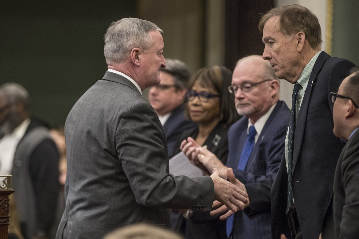 Mayor Kenney, left, turns to shake Councilman Brian J. O'Neill's hand after giving his budget address on March 1.