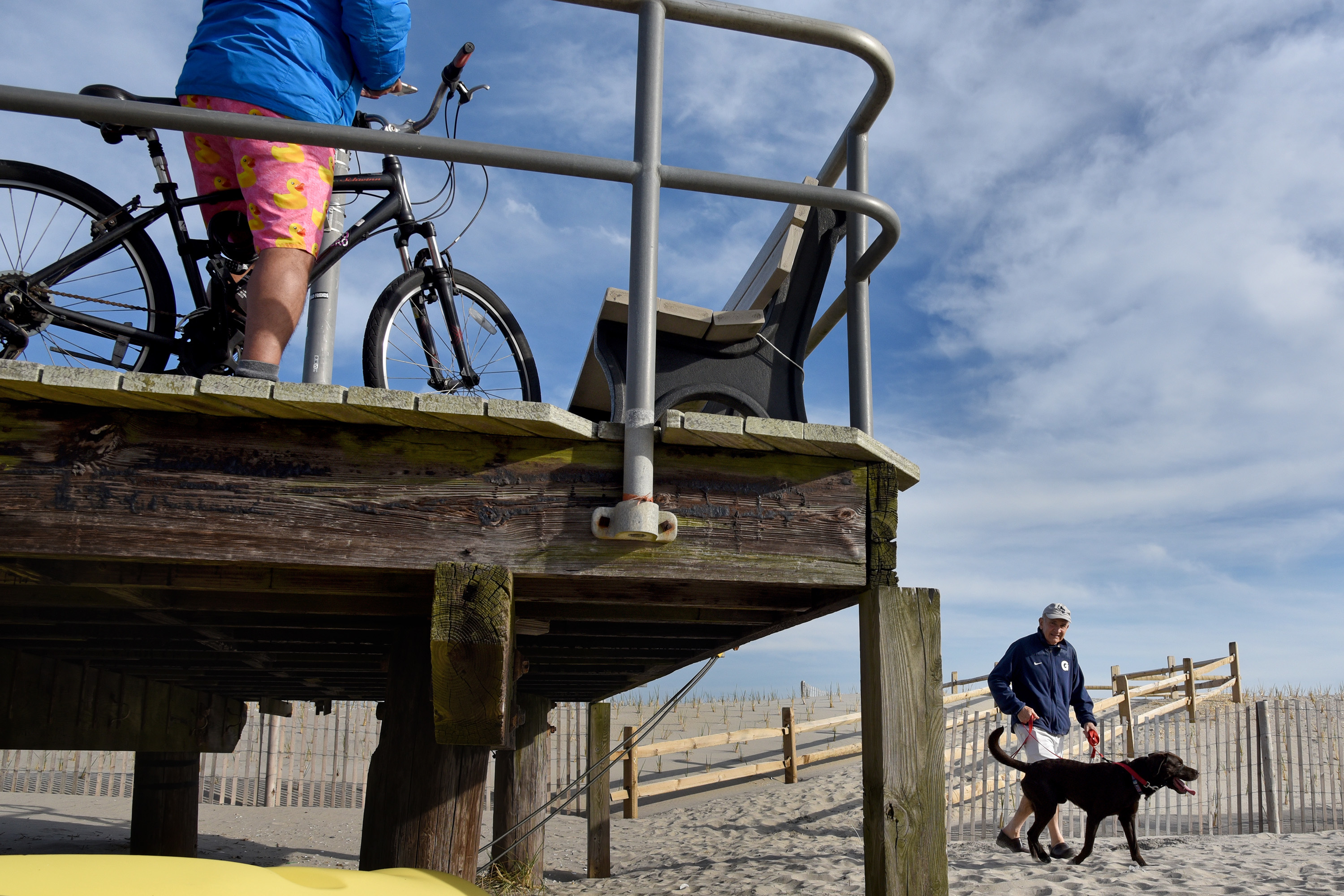 Margate resident Frank Previti walks his chocolate labs near the end of the Ventnor boardwalk where it stops at Fredericksburg Avenue - the border between Ventnor and Margate. Some Margate residents would like to see Ventnor´s boardwalk extended into their town.